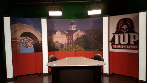 Indiana University of PA Set 5' RPs with cognac birdseye knee wall and graphics across the upper panels and light box columns