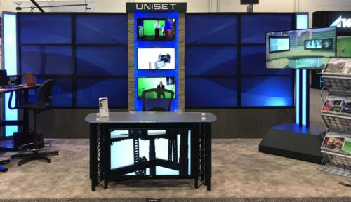Panorama of transition Panels with a graphic and Baileys lower, with custom monitor centerpiece made with faux stone at NAB 2018 trade show floor